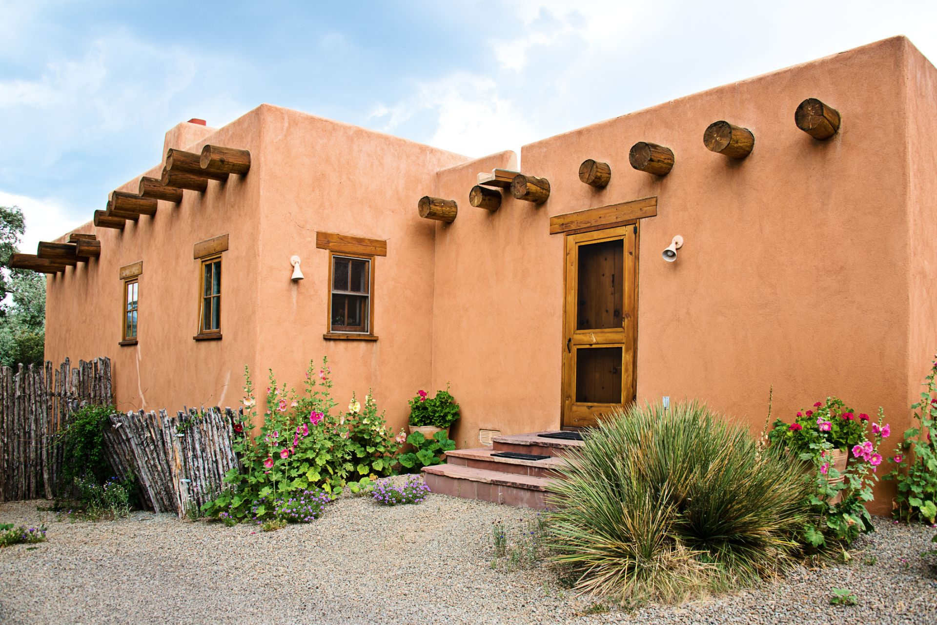 Sant Fe Pueblo-style homes are built with bricks of tightly compacted earth, clay and straw.